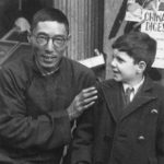 Shanghai newspaper vendor with young Jewish refugee