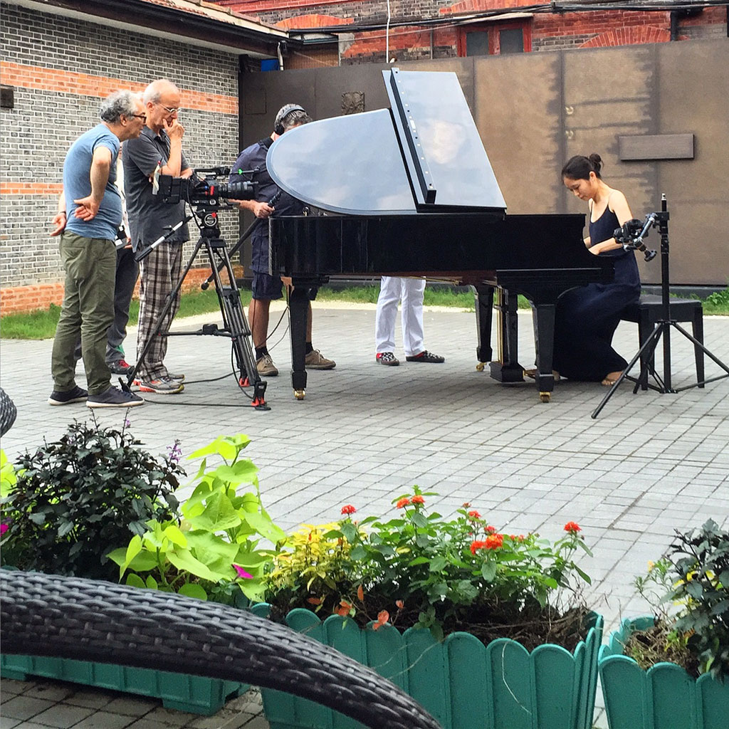 Shooting pianist Zhu Hao Bing in the courtyard of the Shanghai Jewish Refugees Museum; l to r – Nicola Zavaglia, Carlos Ferrand, Olivier Léger.
