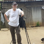 René Balcer filming in the south Yunnan highlands, with his trusty assistant Rusty