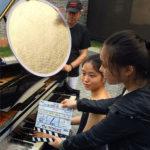 Filming pianist Zhu Hao Bing in Shanghai Jewish Refugees Museum: l to r, René Balcer, Zhu Hao Bing, Liu Zhao Zhen.