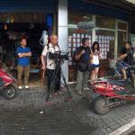 The crew on a street corner in Hongkou